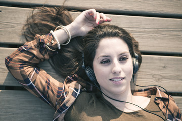 Beautiful Young Woman with Headphones Outdoors