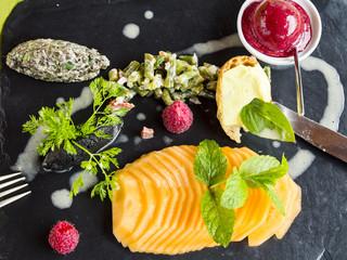 Dramatic gourmet starter on black platter in France