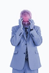 Mature tradesman experiencing a headache