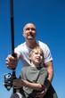 Zdjęcia na płótnie, fototapety, obrazy : Happy man fishing with his son