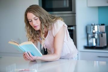 Pretty blonde reading a book