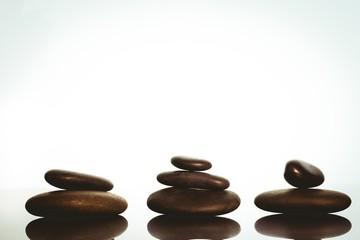 Zen stones balancing on white background