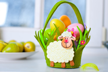 Easter basket with lamb and eggs
