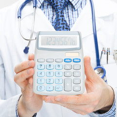 Doctor holding calculator in hands - health care concept
