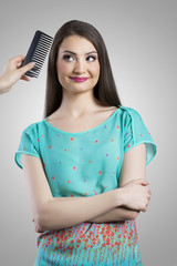 Cute young woman at hairdresser