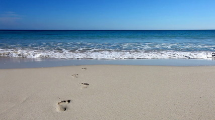 Beach with fresh footprints washed away