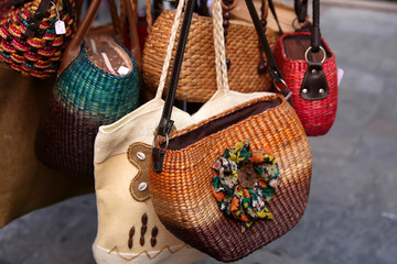Handmade women bags sold at the market. Street shopping for hand