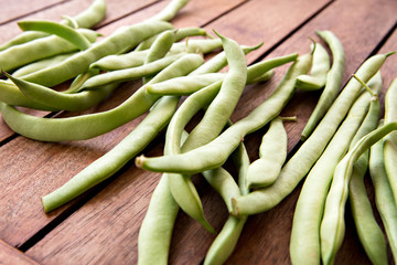 green string beans on wooden table