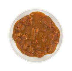 Roast beef in gravy on small plate