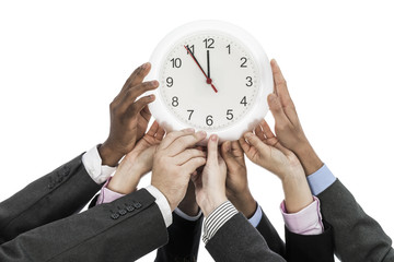 Deadline Business people holding clock