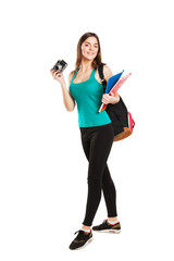 Beautiful young teenager student posing with notebooks and
