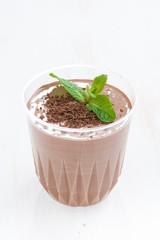 chocolate milkshake in a glass, vertical