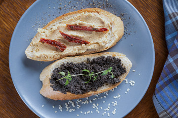 Sandwiches with hummus and tapenade