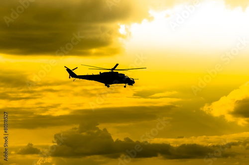 Leinwanddruck Bild combat helicopters Mi-24 against the sky