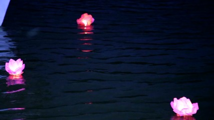 lanterns lights in water. natural night water background