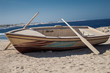 Wooden boat with two oars on beach - 80319931