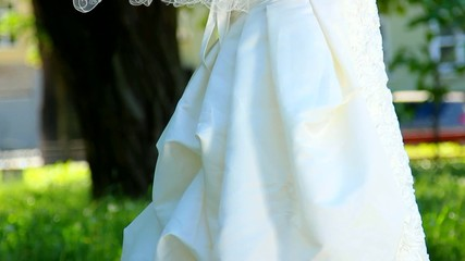 bride in wedding dress with train. bouquet of flowers in hands