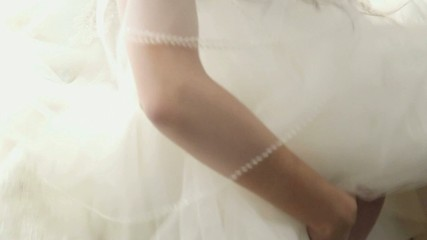 young bride dressing up garter for wedding ceremony