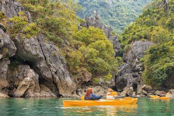 Trip on colourful kayak