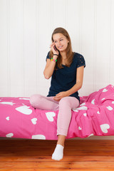 Young teen on the phone