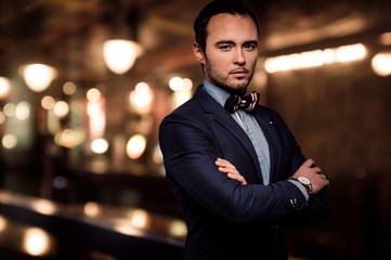Sharp dressed dandy fashionista in elite night club