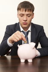 Businessman with pink piggy bank