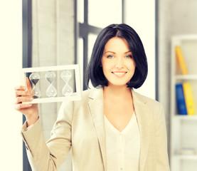 businesswoman holding hourglass