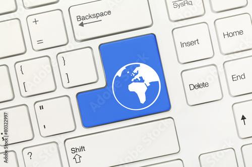 Leinwandbild Motiv White conceptual keyboard - Blue key with world symbol