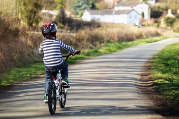 Boy learning to ride his bike