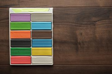 multicolored plasticine bars on the table