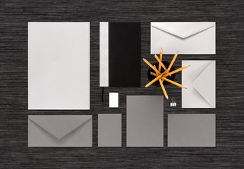 Top view of gray and silver color branding business mock-up on b