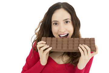 Woman biting a big chocolate bar
