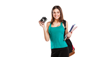 Beautiful young female student posing with notebooks and camera