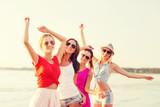 Fototapety group of smiling women dancing on beach