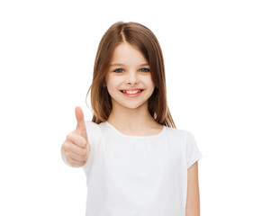 little girl in blank white tshirt showing thumbsup