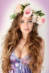 Beautiful women supermodel in wreath of flowers portrait.