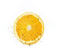 Sliced Orange in Water Splash on white