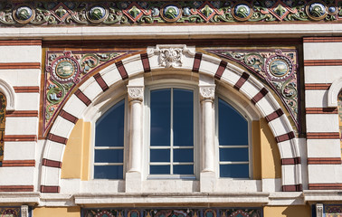 Arched window with colorful ornaments of beautiful building