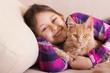 child hugging a kitten