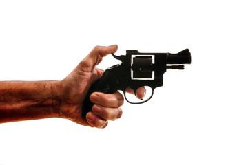 Silhouette of a mans hand with a handgun