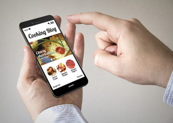 touchscreen smartphone with online cooking blog on the screen