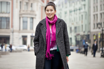Young beautiful asian woman in stylish gray coat