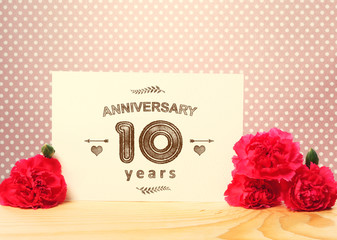 10 years anniversary card with pink carnations