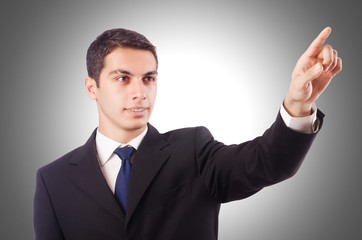 Young businessman pressing virtual buttons