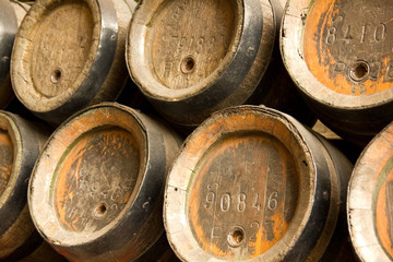 Row of wooden beer barrels