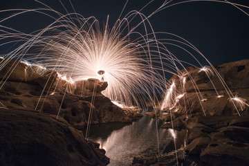 Fire spinning on the canyon Thailand