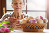 Fototapety Senior woman with easter eggs