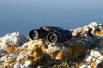 Binoculars on the rock