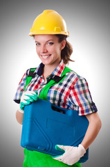 Young woman with toolkit on white