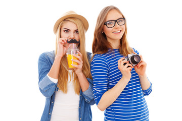 Two hipster girls isolated on white background